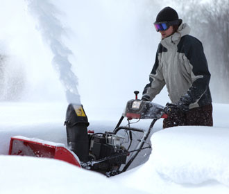 Man Plowing Snow