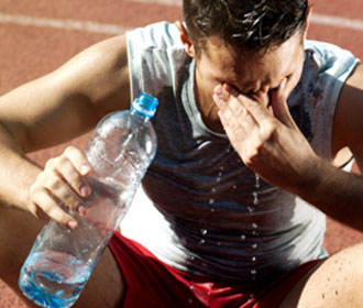 Person Pouring Water On Themselves After Exercising