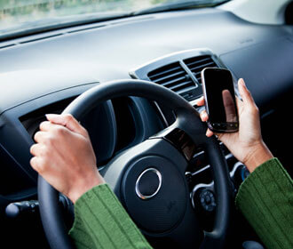 Person Driving and Holding Their Phone