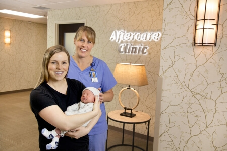 Paige and Sawyer Wilhelmy with Jen Nylund, RN, at St. Luke's Birthing Center just outside the AfterCare Clinic