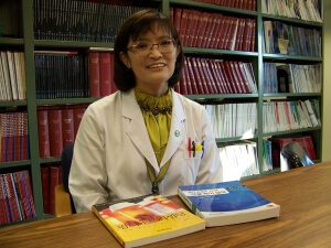 Sunghee Park with the Korean translation of Pharmaceutical Care Practice: The Clinician's Guide (right) and her own book, Pharm D and Precepting (left).