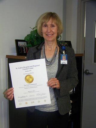 Kathy Johnson, St. Luke's Director of Quality Management, displays The Joint Commission Accreditation Award.