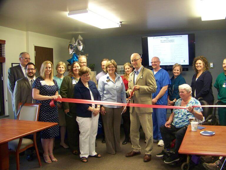 Dr. Samuel Laney, Medical Director of St. Luke's Inpatient Rehabilitation Unit, cuts the ribbon to the newly remodeled unit with the Duluth Chamber.